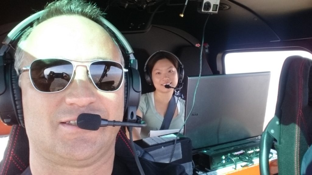 Figure 2: Flight Test Pilot Rucie Moore and Flight Test Engineer Bonnie Yam, taking a moment between maneuvers for a picture together.