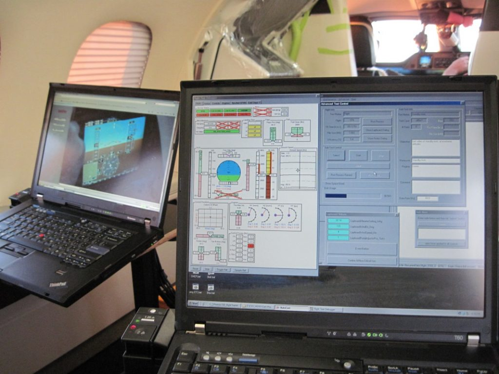 Figure 2: The flight test engineer's station with laptops to monitor flight parameters, cockpit video, and to control aspects of data recording